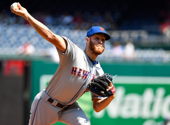 New York Mets starting pitcher Zack Wheeler (45) throws to the Washington Nationals during the first inning at Nationals Park.