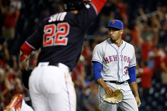 New York Mets relief pitcher Edwin Diaz, right, walks off the field as Washington Nationals' Juan Soto scores on Kurt Suzuki's game-winning three-run home run during the ninth inning of a baseball game Tuesday, Sept. 3, 2019, in Washington. Washington won 11-10.