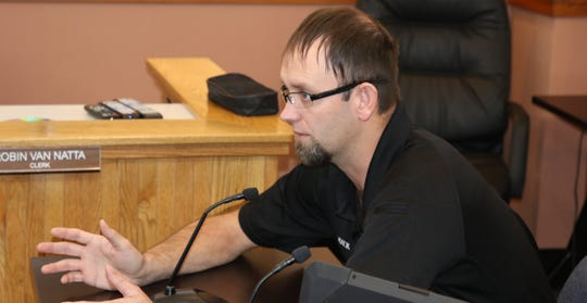Eddy County Fire Services Director Joshua Mack ponders the future of the Loving Volunteer Fire Department during Tuesday's Eddy County Board of Commissioners meeting in Carlsbad.