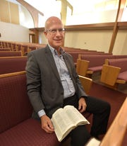 Pastor Mark McGilvrey in his Compass Christian Church on Five Mile Road in Livonia.