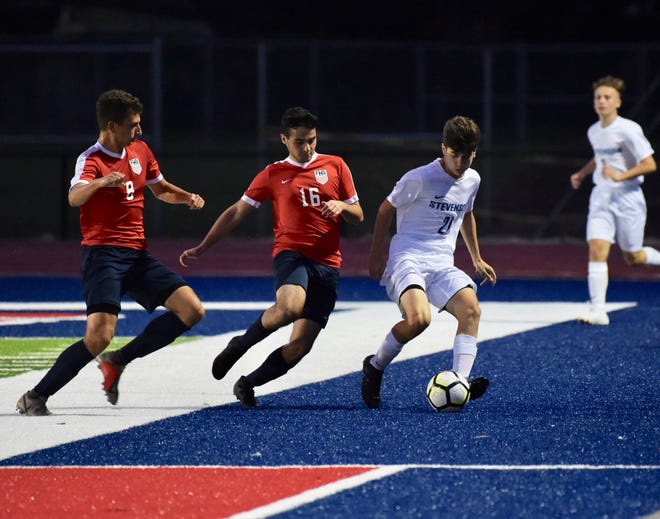 Livonia Stevenson freshman midfielder Nico Bunda attempts to fund an opening in a game against Livonia  Franklin on Sept. 3.