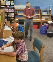 Steppingstone teacher Steve Calbert watches over students Felix Thomason, 7, left, and Alex Wilson on Sept. 4 at the Plymouth school.