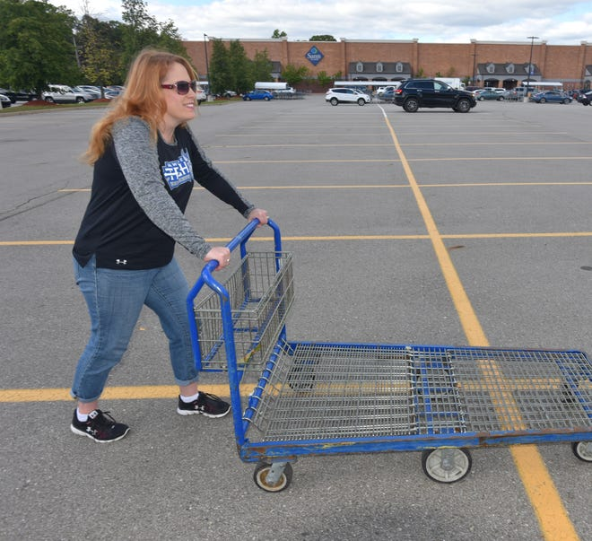 Canton resident Emily Florence was pleasantly surprised by some helpful good Samaritans Sunday afternoon in the parking lot of the Canton Sam's Club.