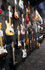 The shelves of the new Guitar Center are stocked and ready for customers on Wednesday.