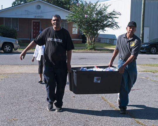 The Rev. Jesse Turner and Larry Smith prepare for a community event Wednesday at the Talbot Chapel African Methodist Episcopal Zion Church in Belmont-DeVilliers.