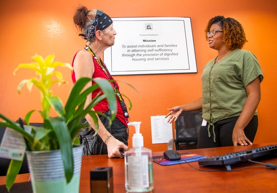 Lisa Klein, left, a resident at 209 W. Jackson, speaks with case manager Tanesia Goodrich, Sept. 3, 2019. The facility, run by Arizona Housing, Inc., provides supportive housing to combat homelessness.