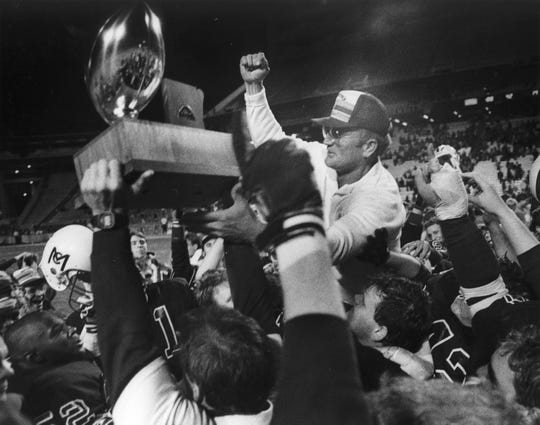 McClintock coach Karl Kiefer is carried off the field by his team after winning the state title in 1989.