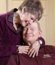 Karl Kiefer and his wife, Sharon, share a moment in their assisted living facility in Chandler.