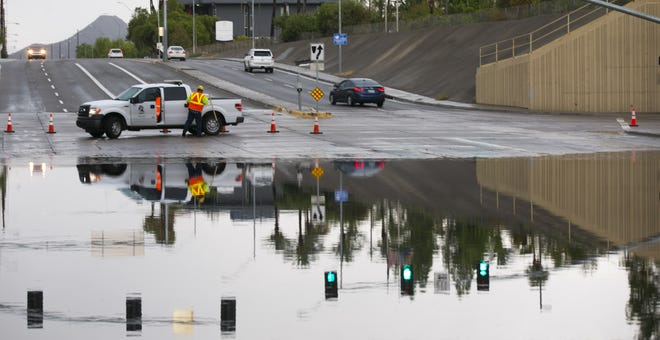 Flooding on Greenway Road under Interstate 17 closed Greenway Road in Phoenix on Aug. 5, 2016.