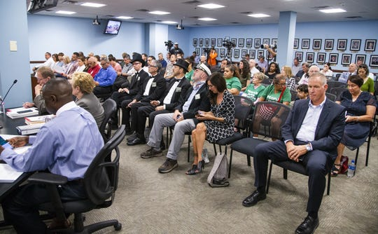 A small crowd listens as Don Brandt, CEO of Arizona Public Service and its parent company, Pinnacle West Capital Corp., answers questions before the  Arizona Corporation Commission in Phoenix on Sept. 4, 2019.
