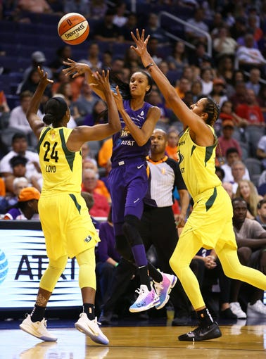 Phoenix Mercury forward DeWanna Bonner makes a pass with pressure from the Seattle Storm in the first half on Sep. 3, 2019 in Phoenix, Ariz.