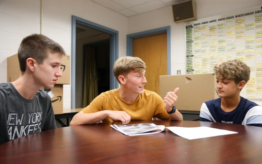 Red Hook High School senior Chris Donohue, at center, speaks with his mentees, from left, Liam Boyd and Gabe Gravino on the first day of school on September 4, 2019.