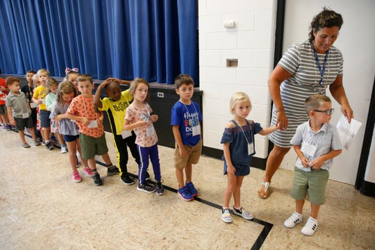 Elm Drive Elementary School kindergarten teacher Samantha Bopp guides students on a tour of the building on September 4, 2019.