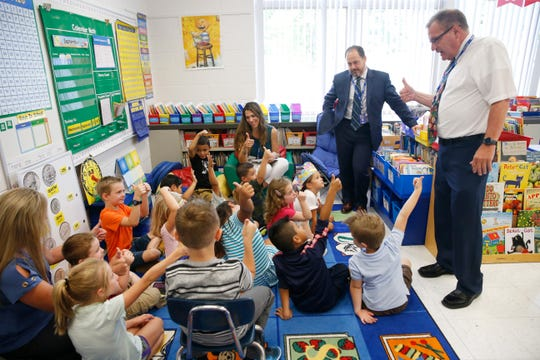 Elm Drive Elementary School teacher Joann Hobson reads to her students with, from left, district assistant superintendent Brian Fried and superintendent Philip D'Angelo during the first day of school on September 4, 2019.