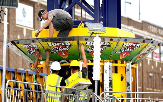 Workers construct rides on the York Fair midway Wednesday, Sept. 4, 2019. The York Fair opens Friday and runs through Sept. 16. Bill Kalina photo
