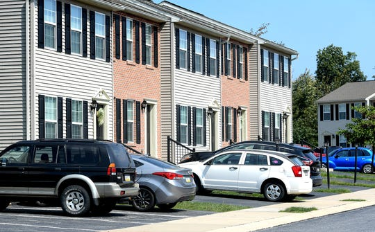 Cars are parked along townhomes at Greenbriar Estates Wednesday, Sept. 4, 2019. The Conewago Board of Supervisors voted unanimously to approve the final plans for the construction of a community center in the townhouse development. Bill Kalina photo