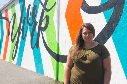"""Chelsea Foster designed the """"York"""" mural in Royal Square District. It is one of 14 murals now within the downtown York neighborhood."""
