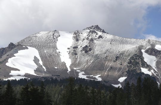 A summer storm leaves a dusting of snow on Lassen Peak. Established in 1916, Lassen Volcanic National Park is about an hour's drive east of Redding.