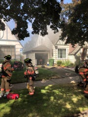 Crews from Salem Fire Department tackle a house fire on 18th Street.