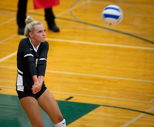 West Salem's Kayla Neidigh, (1), returns a serve during their game against North Medford at West Salem High School in Salem, Oregon September 3, 2019.