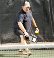 A pickleball player competes in men's doubles during league play at Bentwood Country Club Tuesday, Sept. 3, 2019. The 2019 Slamfest will feature tennis and pickleball at Bentwood on Saturday and Sunday. Four top pickleball pros will be in town.