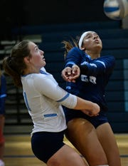 Airline's Tori Ligman and Gabby Patronis dig one out in their game Tuesay against Parkway.