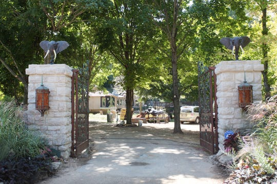 Statues of elephant heads were once atop the stone pillars at the entry gate to The African Queen, 2829 S. Lone Pine Ave. The statues are gone; a bank owns the home; and former owner Michael Willhoit faces federal charges of bank fraud.