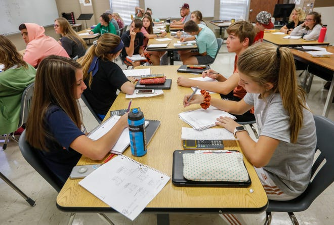 Spokane High School students take notes during an Algebra I course. The Spokane district operates on a four-day school week, Tuesday through Friday.