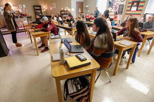 English 2 teacher Briana Ashby, left, teaches her students about writing a memoir at Spokane High School on Wednesday, Sep. 4, 2019, in Spokane, Mo.