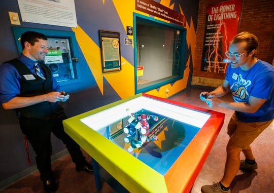 Rob Blevins, executive director of the Discovery Center, and Matthew Hyde, the community engagement coordinator, fight each other using battling robots on Wednesday, Sept. 4, 2019. The robot are one of the many interactive exhibits guests can use during the 4th annual Night at the Museum, which raises funding for the Discovery Center's STEM Education for All program on Saturday.