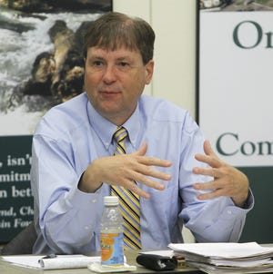 In this 2012 file photo, former News-Leader executive editor David Stoeffler leads a discussion during an Every Child committee meeting. Stoeffler will be honored this week for his work in bringing to light the impact of poverty on the community's children during his tenure in Springfield.