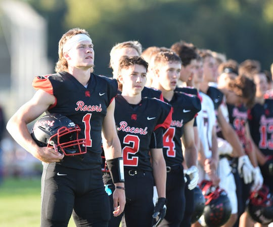 Rocori players line up for introductions before the start of their first game of the season in Cold Spring.