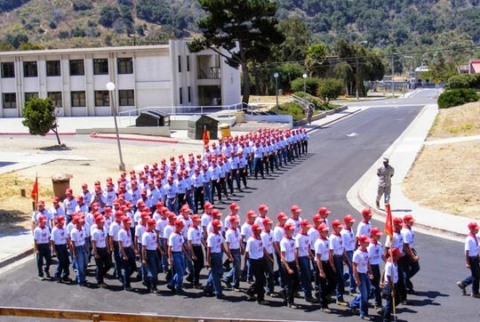 Members of the Southern Utah 'Devil Pup' candidates march with other participants from around the country in a march to camp at Camp Pendleton, California, on July 25, 2019.
