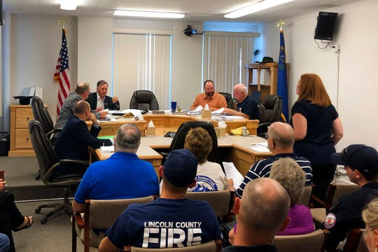 """Lincoln County Commission members meet Tuesday, Sept. 3, 2019, in Pioche, Nev. The board gave final go-aheads to two events Sept. 20-22 centered around a """"Storm Area 51"""" drive that began as an internet joke. A promoter plans to host a music festival for 5,000 people in tiny Hiko. The owner of the Little A'Le'Inn says she's clearing campsites for perhaps 10,000 people in Rachel, the town closest to the once top-secret Area 51 military base. (AP Photo/Ken Ritter)"""