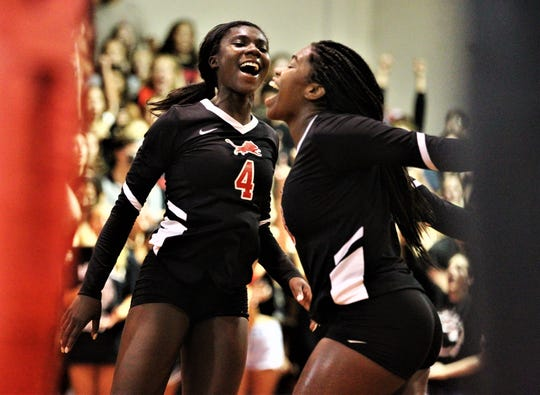 Leon's Shania Cromartie (4) and Cailin Demps celebrate a point as Leon swept Florida High 3-0 on Tuesday, Sept. 3, 2019.