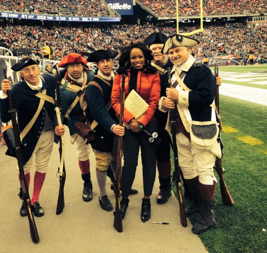 NFL on Fox sideline reporter Pam Oliver poses with the New England Patriots Minutemen at Gillette Stadium in Foxborough, Massachusetts. Oliver is a Florida A&M School of Journalism & Graphic Communication graduate and former track star with the Rattlers.