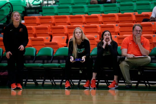 Florida A&M Rattlers Jessa Long, left, Radka Dimitrova, center, and Aybuke Kocabiyik watch the action during the home opener against Mercer at the Al Lawson Center Tuesday, Sept. 3, 2019.