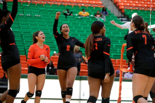 Florida A&M volleyball co-captain Alexis Gosha (8) leads the cheers after a winning point during a game between in the home opener versus Mercer at the Al Lawson Center Tuesday, Sept. 3, 2019.