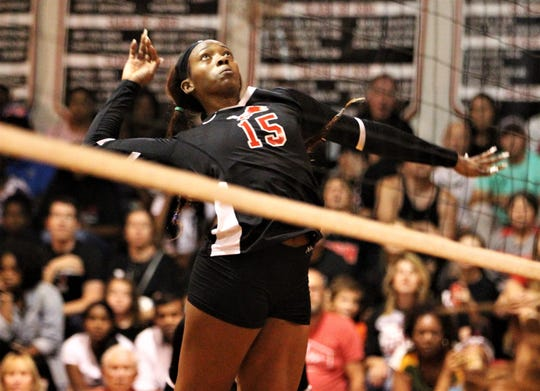 Leon senior A'Nylah Cobb goes up for a kill as Leon swept Florida High 3-0 on Tuesday, Sept. 3, 2019.