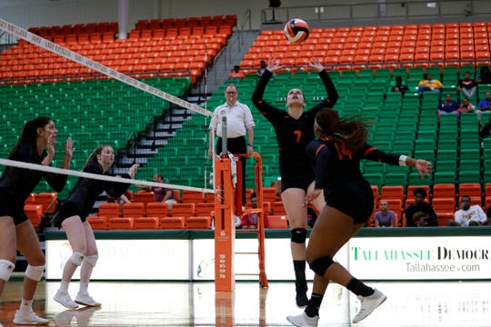 Florida A&M setter Ilayda Nurkan (7) puts the volleyball up for Alexys Mann (14) for a hit during a game versus Mercer at the Al Lawson Multipurpose Center Tuesday, Sept. 3, 2019.