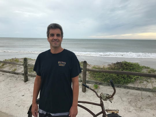 Greg Brost, of Vero Beach, took his bike out for a ride to Conn Beach to check surf conditions Wednesday, Sept. 4, 2019.