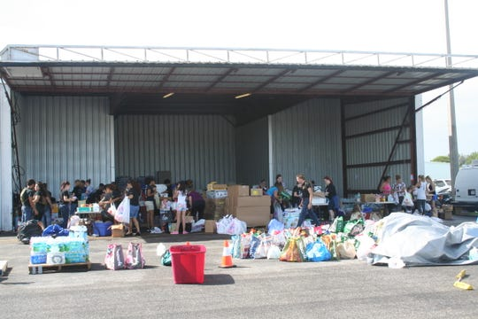 Volunteers sort through donations at the Stuart Jet Center during Hurricane Matthew relief efforts in October 2016.