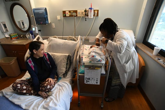 Pediatrician Dr. Kerri Daniels checks in on newborn baby Samuel Chin-Yet Wednesday, Sept. 4, 2019, as his mother Cecilia looks on. Samuel was born at 1:05 a.m. the day before at St. Lucie Medical Center, as Hurricane Dorian was passing the Treasure Coast.