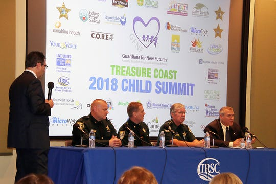 WPTV NewsChannel 5's Jon Shainman, left, facilitates of panel of law enforcement  representatives from Martin, Okeechobee, Indian River and St. Lucie counties.