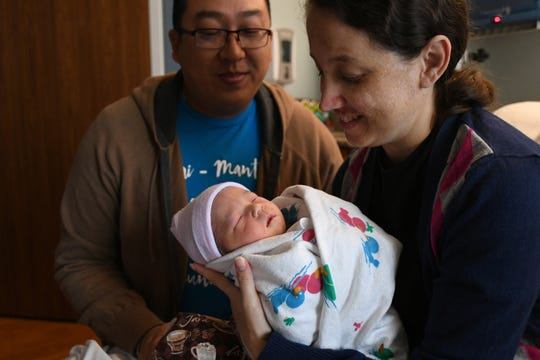 Parents Brian (left) and Cecilia Chin-Yet hold their newborn son Samuel, born at 1:05 a.m. at the St. Lucie Medical Center, as Hurricane Dorian was passing the Treasure Coast Tuesday, Sept. 3, in Port St. Lucie.