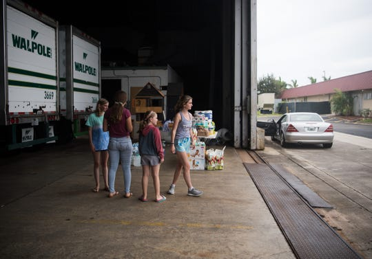 Local relief efforts for the Bahamas, devastated by Hurricane Dorian, get underway as Operation 300 runs a collection in Hangar 3 at Witham Field on Wednesday , Sept. 4, 2019, in Martin County.