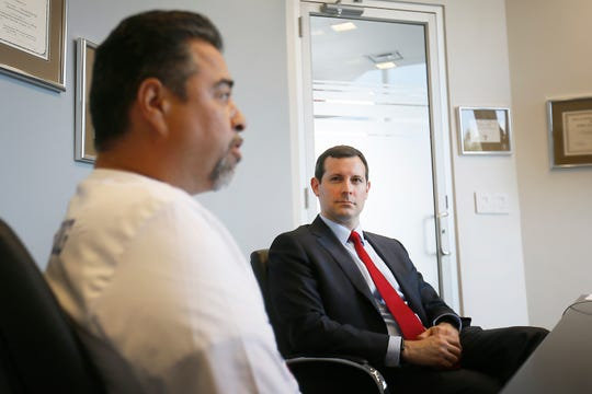 Lawyer Patrick Luff listens to Don Coca, father of Walmart shooting victim Jessica Garcia, talk Wednesday, Sept. 4, 2019, about the lawsuit filed against Walmart at James Kennedy PLLC in El Paso. Jessica and Guillermo Garcia, who were both severely injured in the Aug. 3 mass shooting, filed the lawsuit against Walmart Inc. and Wal-Mart Stores Texas LLC on Aug. 30 in El Paso County district court.