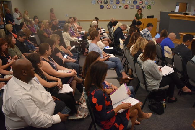 Community members pack a Conejo Valley Unified School District Board of Education meeting.