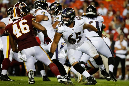 Baltimore offensive lineman Patrick Mekari (65) prepares to block during the second half of a preseason game against Washington last Thursday. The Westlake High graduate made the Ravens' 53-man roster over the weekend.