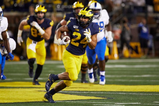 Michigan running back Zach Charbonnet finds an opening during last Saturday's game against Middle Tennessee State. The Oaks Christian graduate led the Wolverines with 90 yards on just eight carries in his first collegiate game.